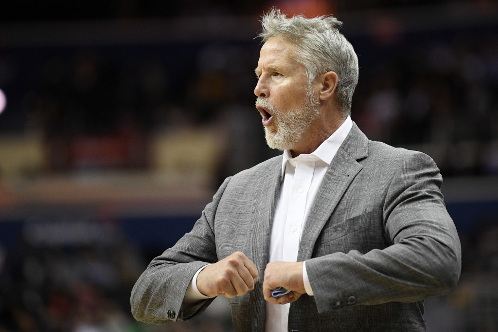Philadelphia 76ers head coach Brett Brown gestures during the second half of an NBA basketball game against the Washington Wizards, Wednesday, Jan. 9,