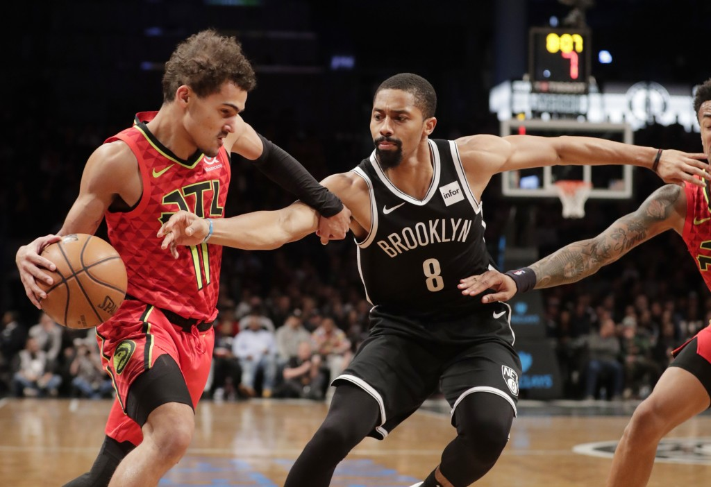 Brooklyn Nets' Spencer Dinwiddie (8) defends against Atlanta Hawks' Trae Young (11) during the first half of an NBA basketball game Wednesday, Jan. 9,