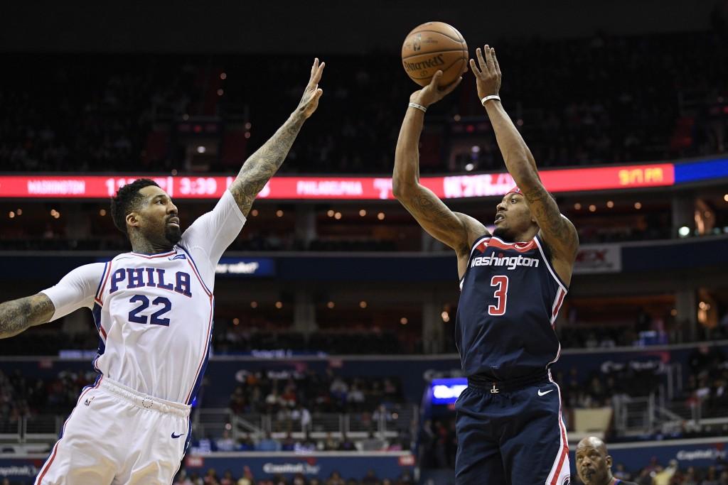 Washington Wizards guard Bradley Beal (3) shoots against Philadelphia 76ers forward Wilson Chandler (22) during the second half of an NBA basketball g...