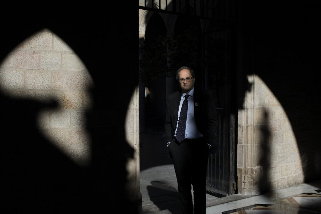 In this Thursday, Jan. 10, 2019 photo, Catalan regional president Quim Torra poses for a photo at the Palace of Generalitat or Catalan government head