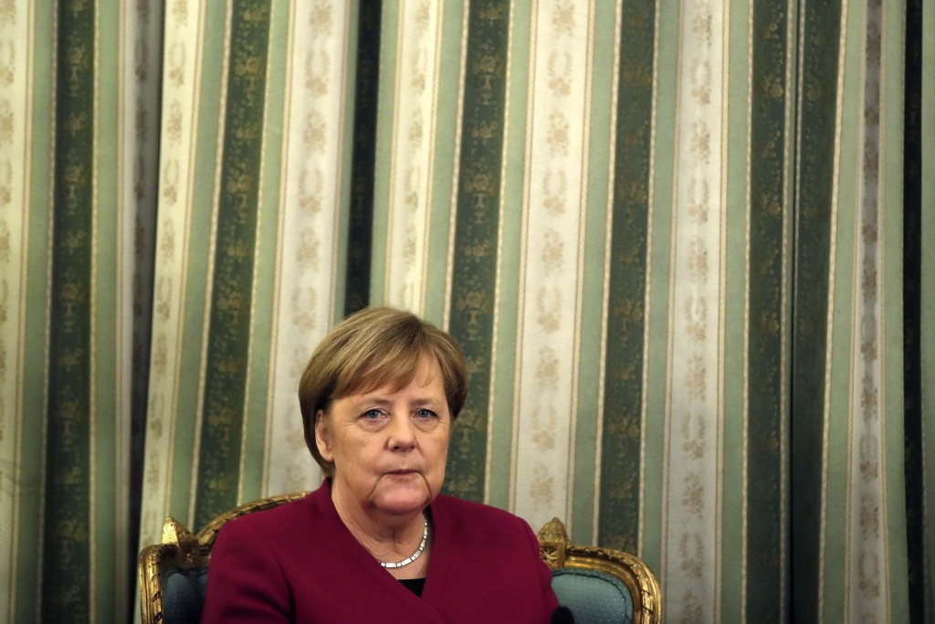 German Chancellor Angela Merkel is seen during a meeting with Greece's President Prokopis Pavlopoulos at the presidential palace in Athens, Friday, Ja...