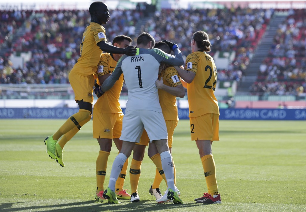 Australia's forward Jamie Maclaren, l2nd right, celebrates with teammates after scoring his side's opening goal during the AFC Asian Cup group B socce