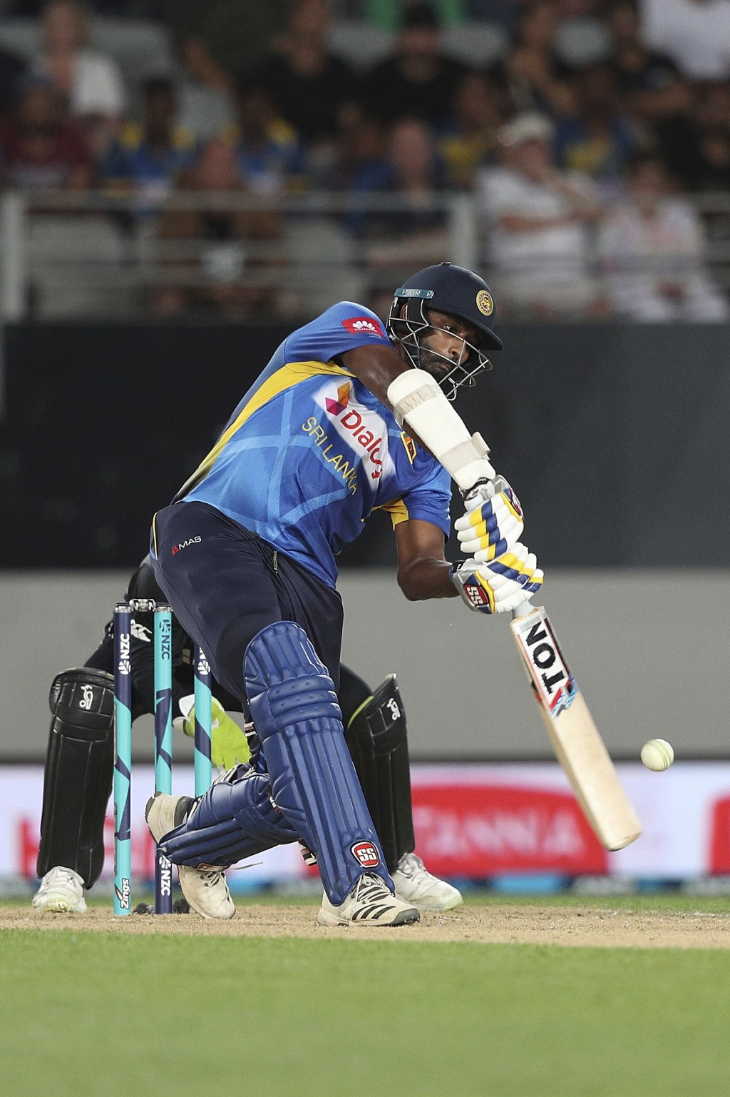 Sri Lanka's Thisara Perera bats watched by New Zealand's Wicketkeeper Tim Seifert during their twenty/20 cricket international at Eden Park in Aucklan