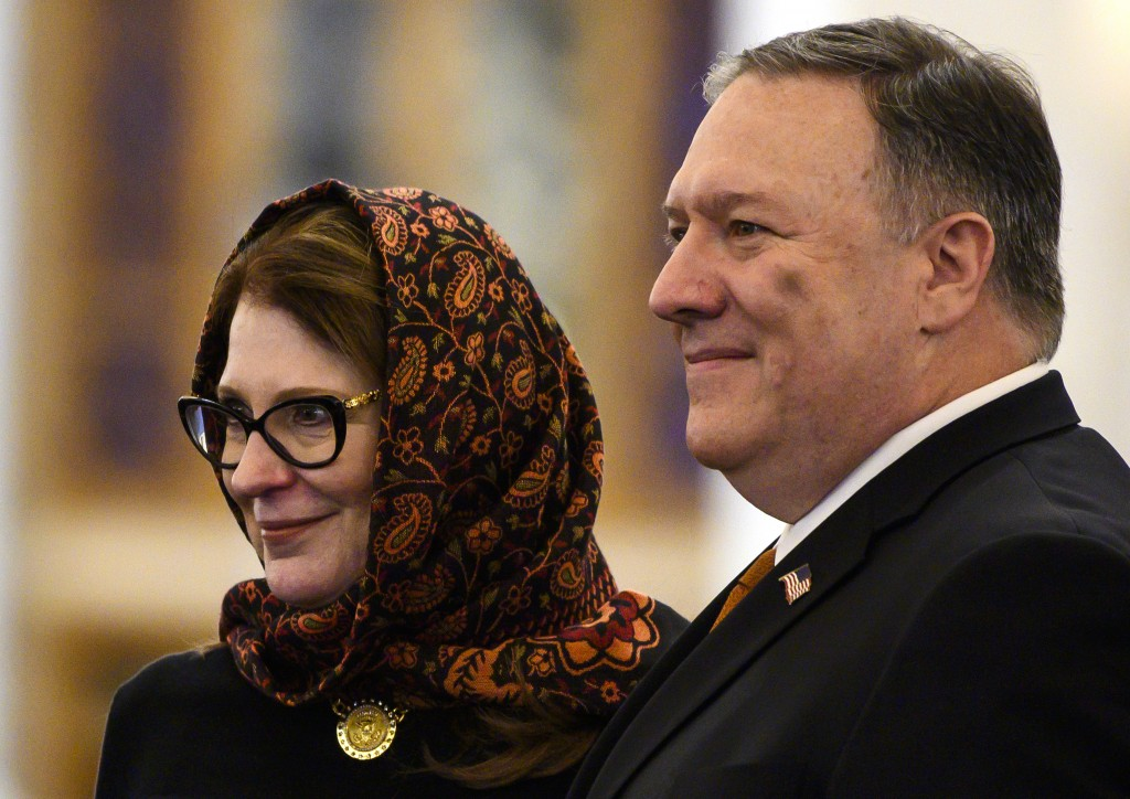 Secretary of State Mike Pompeo and his wife Susan pose for a photo as they tour the newly inaugurated Cathedral of the Nativity Christ, in Egypt's New