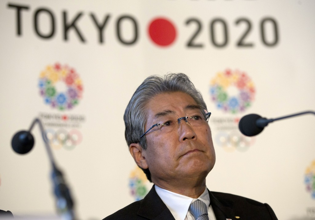 FILE - This is a Thursday, Jan. 10, 2013 file photo of Tsunekazu Takeda, President of the Tokyo 2020 Olympic games bid, as he listens to a question fr...