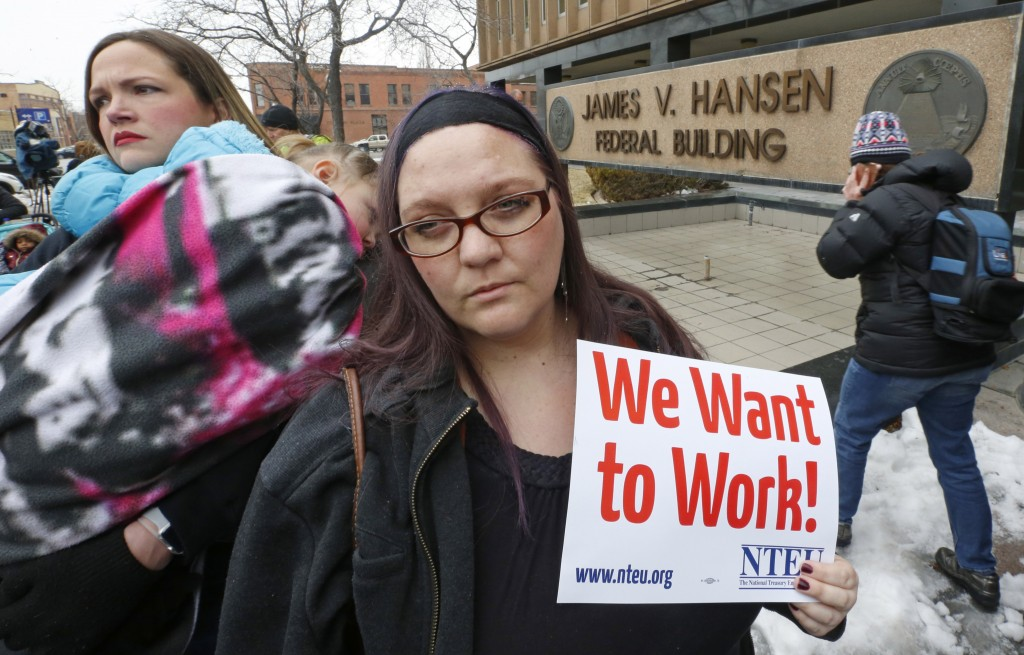 IRS worker Christine Helquist joins a federal workers protest rally outside the Federal Building, Thursday, Jan., 10, 2019, in Ogden, Utah. Payday wil