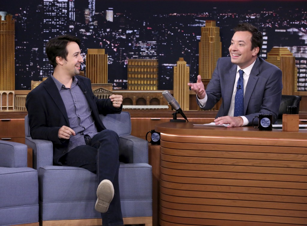 """This Oct. 4, 2016 image released by NBC shows Lin-Manuel Miranda during an interview with host Jimmy Fallon on """"The Tonight Show Starring Jimmy Fallon"""