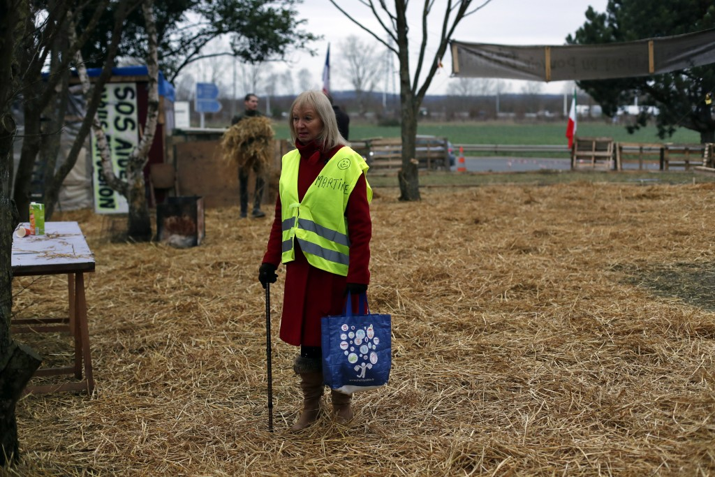 Yellow vest protestor Martine, who refuses to give her family name, stands in a makeshift camp on a roundabout near Senlis, north of Paris, Thursday,