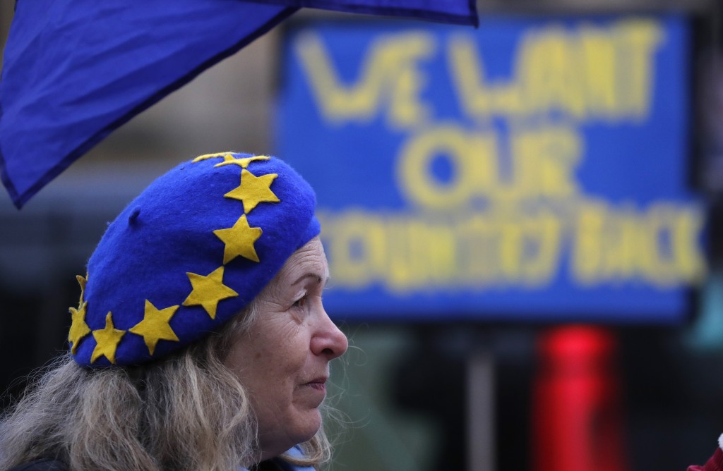 A pro-European demonstrator protests outside parliament in London, Friday, Jan. 11, 2019. Britain's Prime Minister Theresa May is struggling to win su