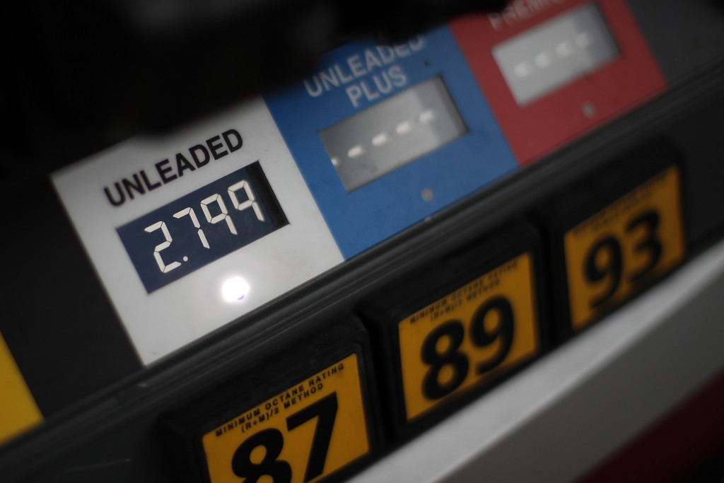 FILE- In this Nov. 16, 2018, file photo the price of gas is displayed at a pump in West Mifflin, Pa. On Friday, Jan. 11, 2019, the Labor Department re