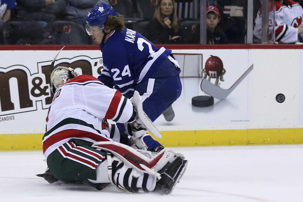 New Jersey Devils goaltender Keith Kinkaid clears the puck past Toronto Maple Leafs right wing Kasperi Kapanen (24) during the first period of an NHL ...