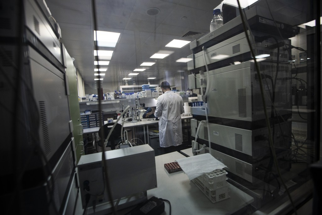 In this photo taken on Tuesday, May 24, 2016, Employees work in Russia's national drug-testing laboratory in Moscow, Russia . World Anti-Doping Agency