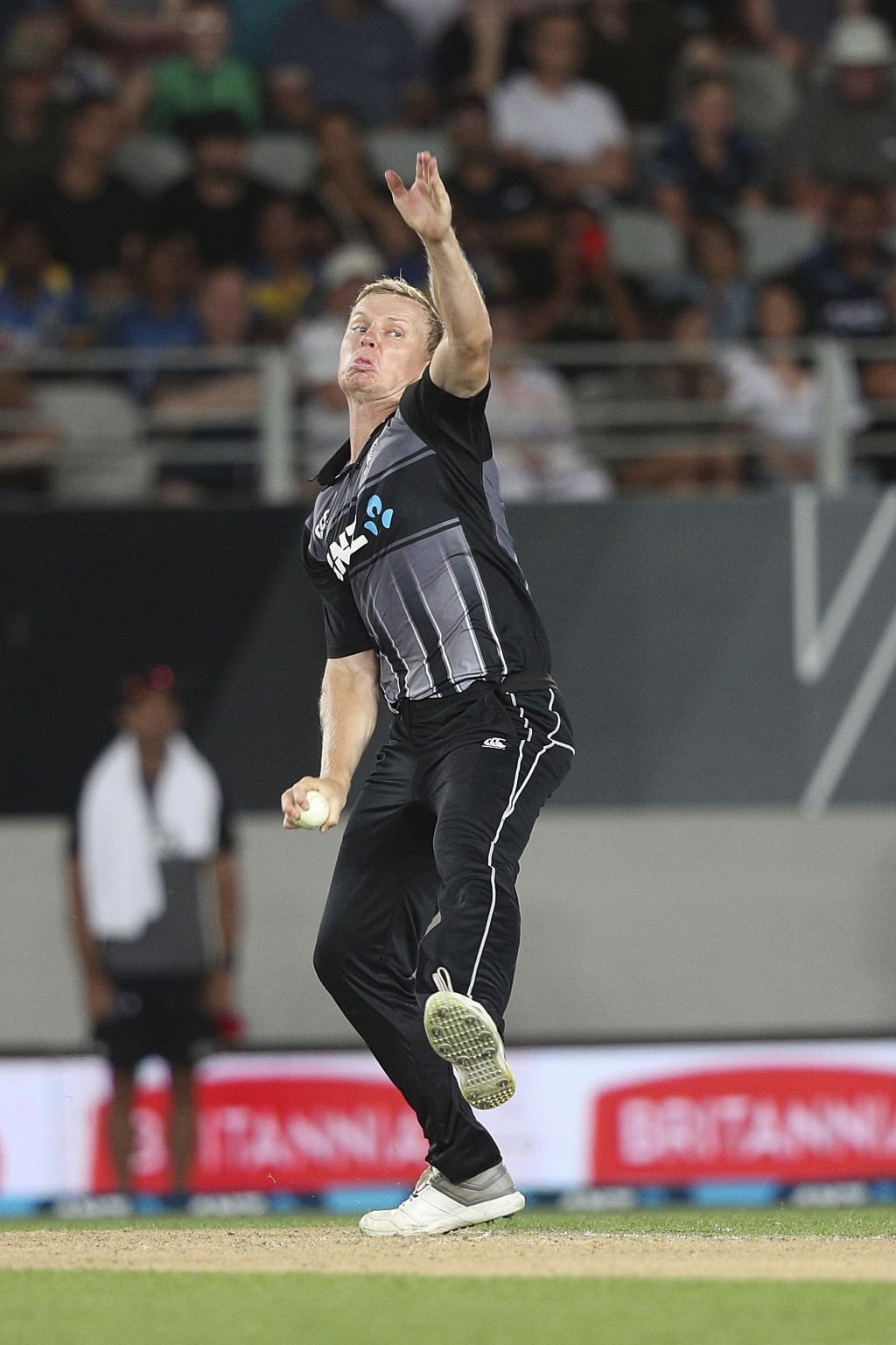 New Zealand's Scott Kuggeleijn bowls during their twenty/20 cricket international at Eden Park in Auckland, New Zealand, Friday, Jan. 11, 2019. (AP Ph