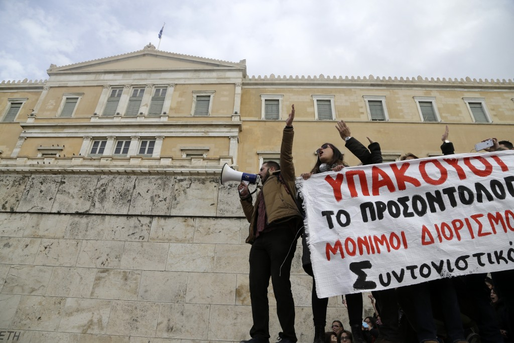 Protesters shout slogans outside the Greek Parliament during a protest in Athens, Friday, Jan. 11, 2019. About 1,500 people took part in the protest.