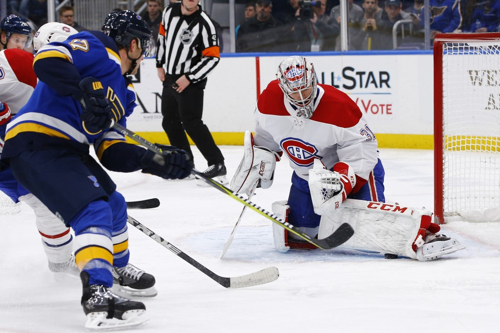 Montreal Canadiens goaltender Carey Price makes a save on a shot by St. Louis Blues' Jaden Schwartz, left, during the second period of an NHL hockey g