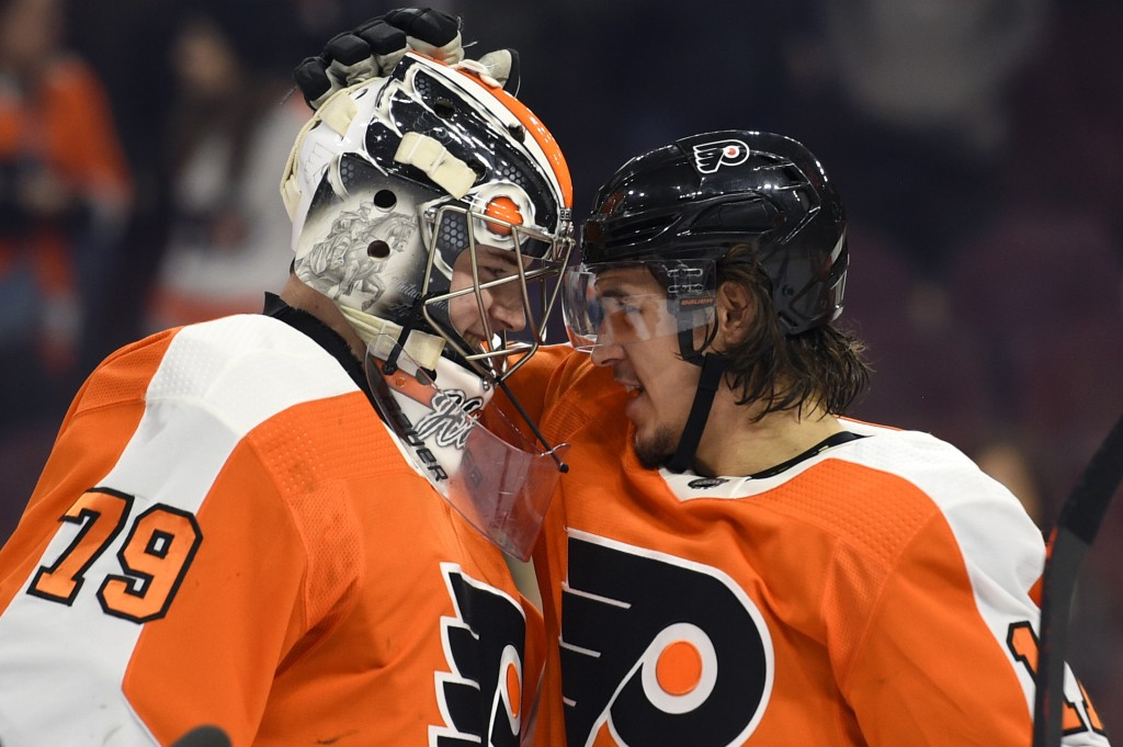Philadelphia Flyers goaltender Carter Hart, left, is congratulated by Travis Konecny after a victory against the Dallas Stars on Thursday, Jan. 10, 20
