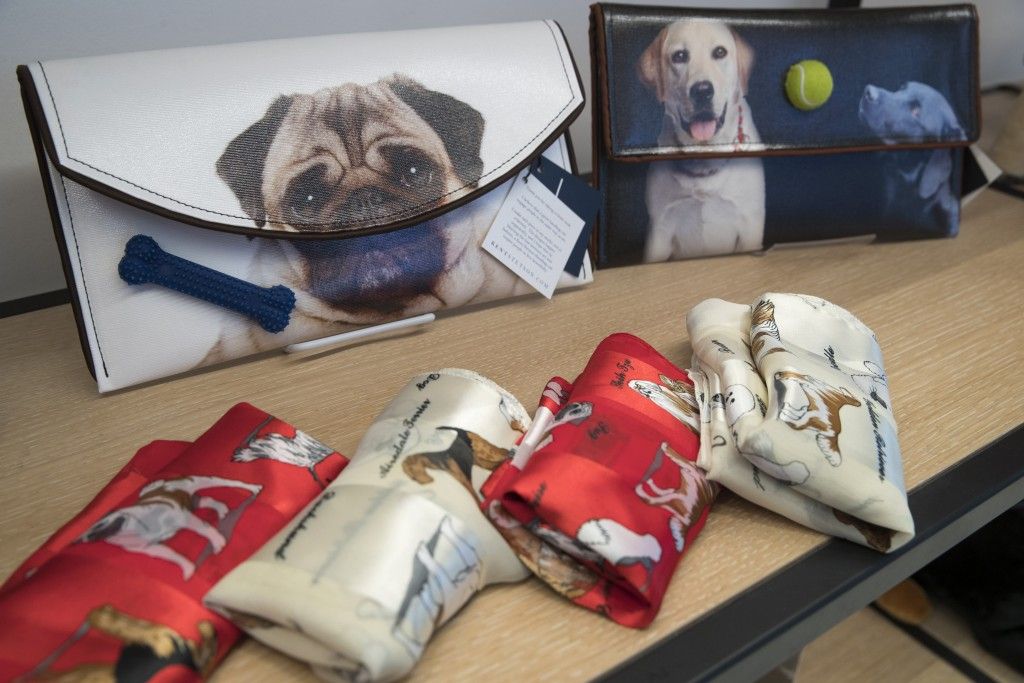 This Wednesday, Jan. 9, 2019, photo shows dog themed scarves and clutches that are on display for sale in the American Kennel Club Museum of the Dog's...