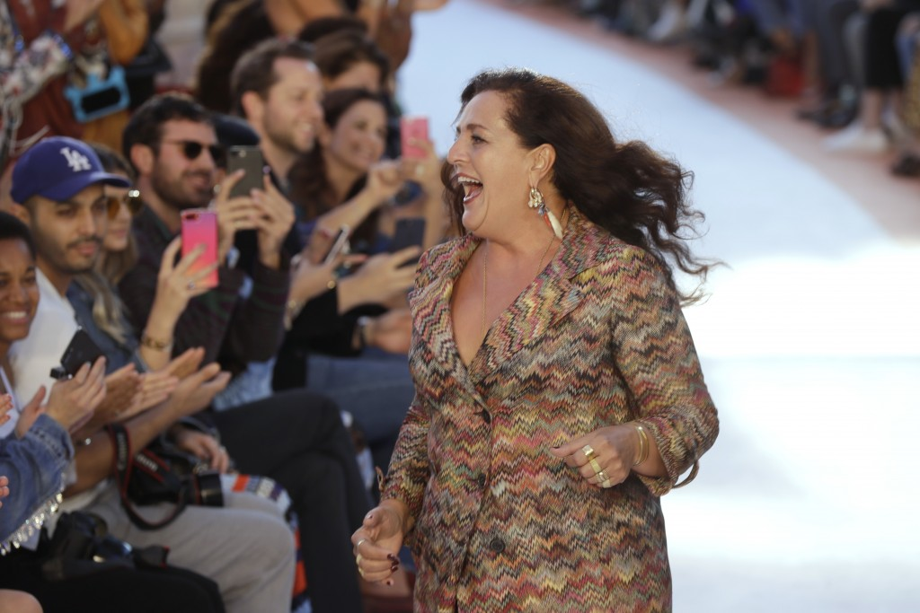 FILE - In this Sept. 23, 2017 file photo designer Angela Missoni acknowledges applauses at the end of the Missoni women's Spring/Summer 2018/19 fashio
