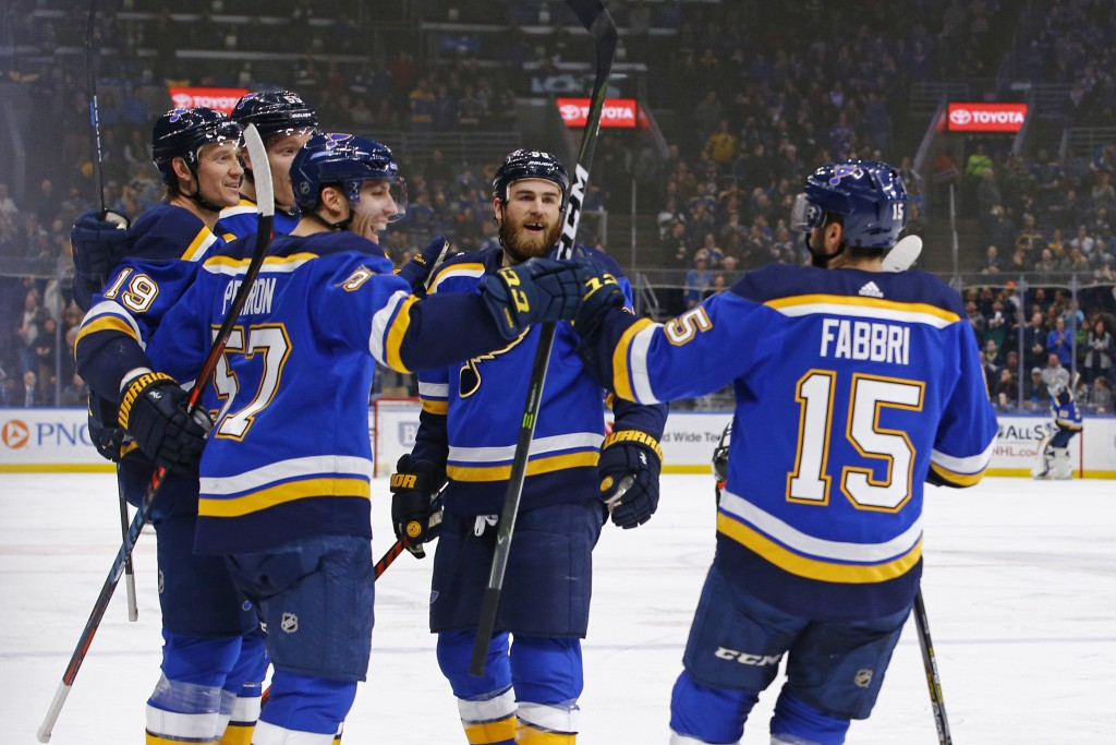 St. Louis Blues' Jay Bouwmeester (19) is congratulated by teammates Colton Parayko (55), David Perron (57), Ryan O'Reilly (90) and Robby Fabbri (15) a