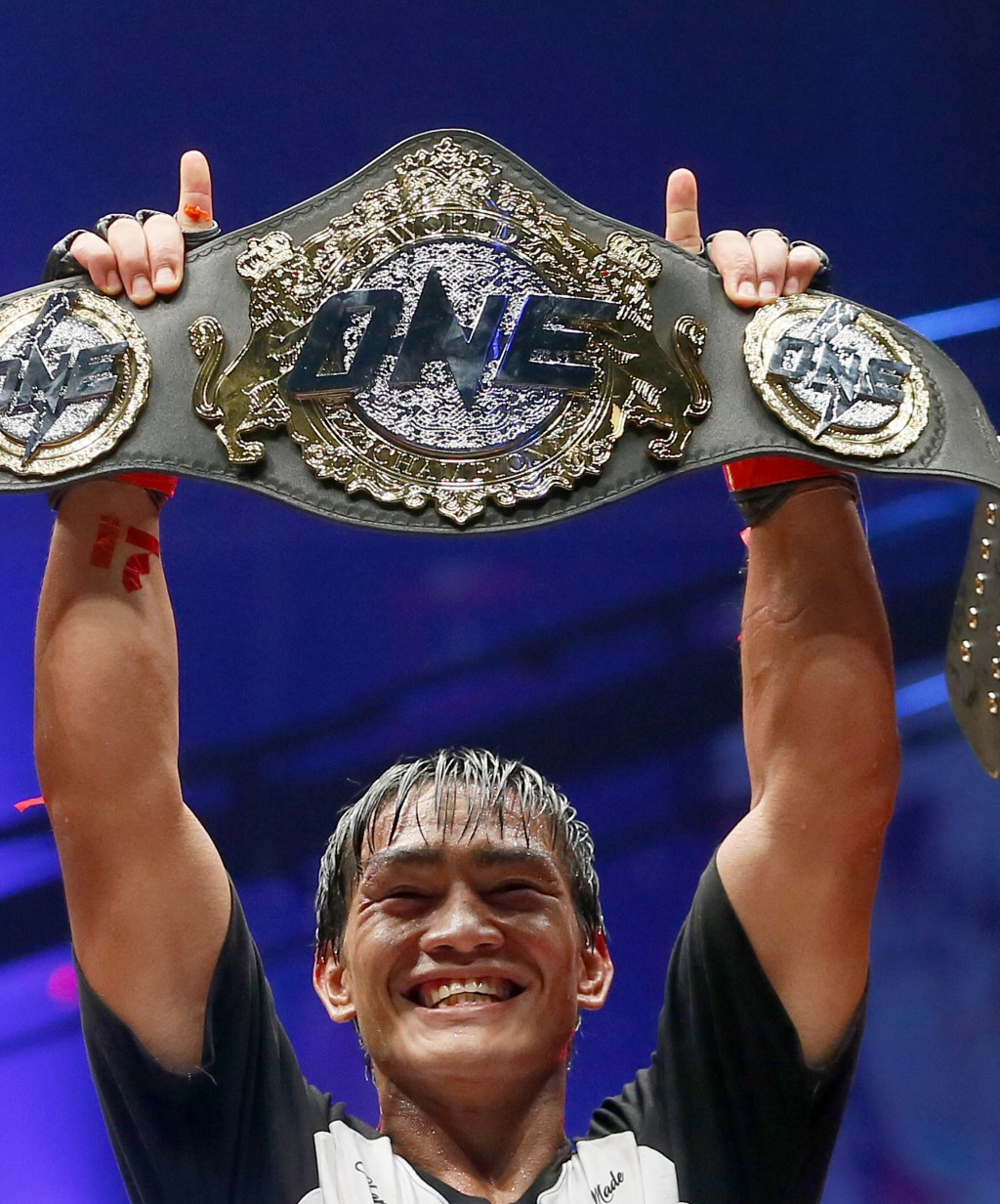 FILE - In this April 21, 2017, file photo, Philippines' Eduard Folayang raises his championship belt during an award ceremony after beating Malaysian-