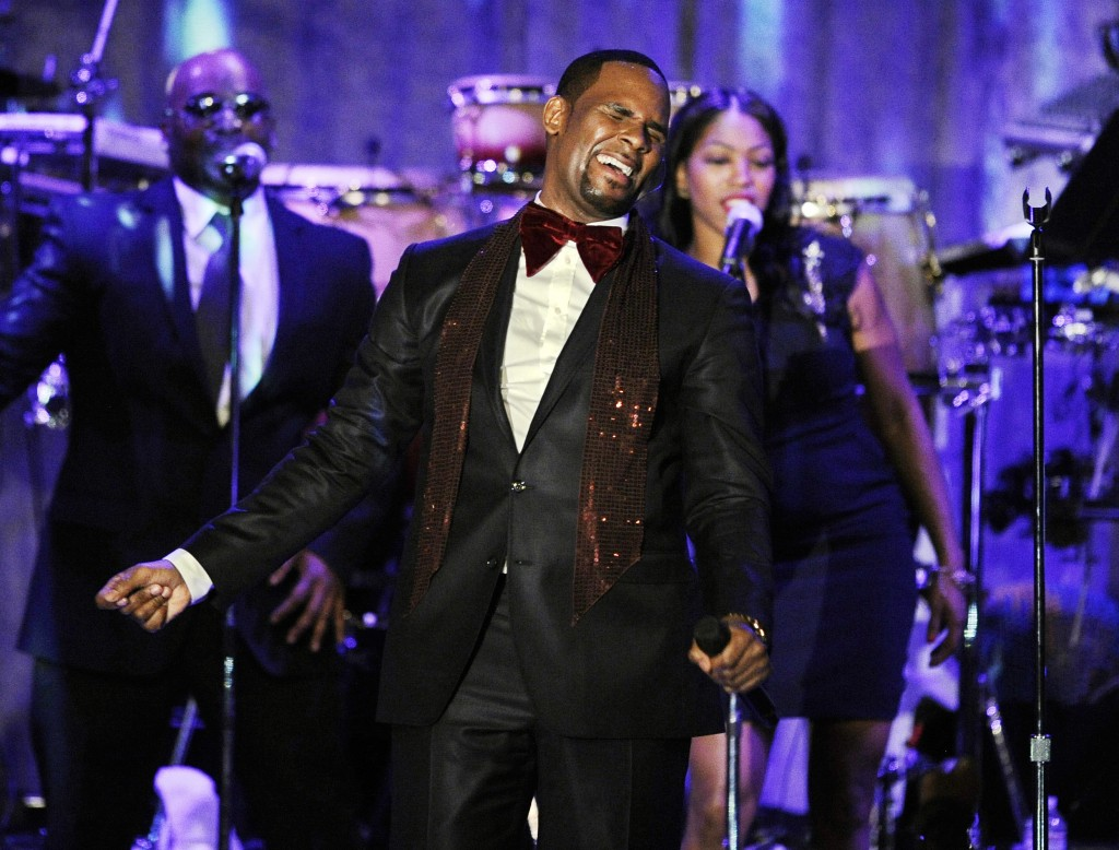 FILE - This Feb. 12, 2011 file photo shows R. Kelly performing at the pre-Grammy gala & salute to industry icons with Clive Davis honoring David Geffe...