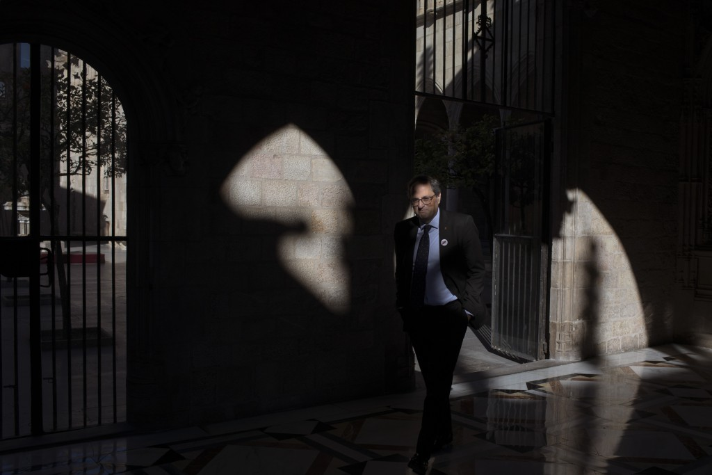 In this Thursday, Jan. 10, 2019 photo, Catalan regional president Quim Torra walks at the Palace of Generalitat or Catalan government headquarters, ah