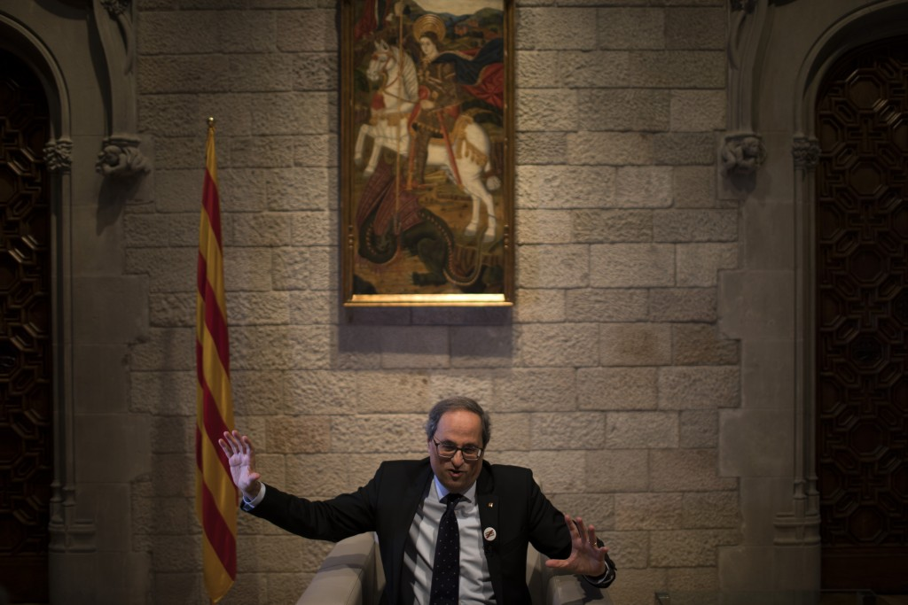 In this Thursday, Jan. 10, 2019 photo, Catalan regional president Quim Torra speaks during an interview with the Associated Press, at the Palace of Ge
