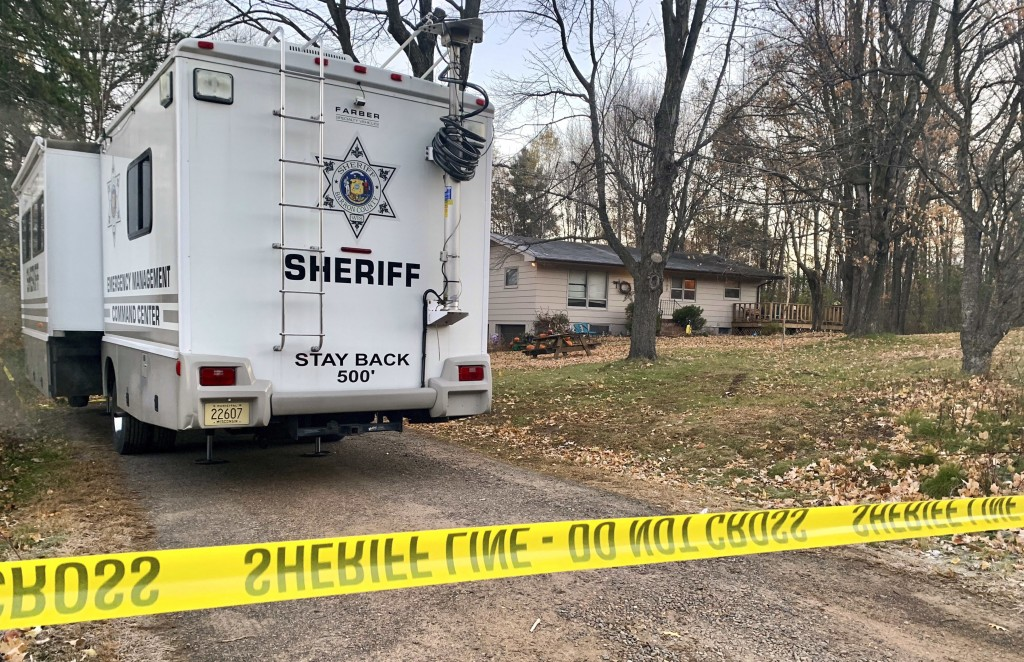 FILE - In this Oct. 23, 2018, file photo, a Barron County, Wis., sheriff's vehicle is parked outside the home where James Closs and Denise Closs were
