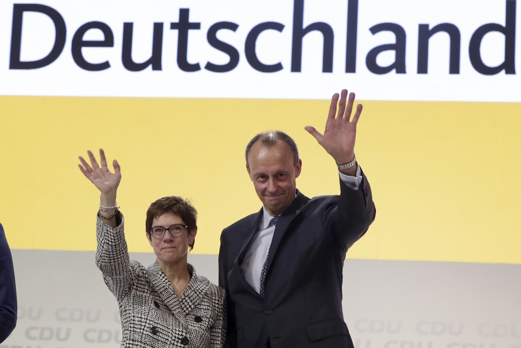 FILE - In this Dec. 7, 2018 file photo newly elected CDU chairwoman Annegret Kramp-Karrenbauer, left, and Friedrich Merz, right, wave during the party