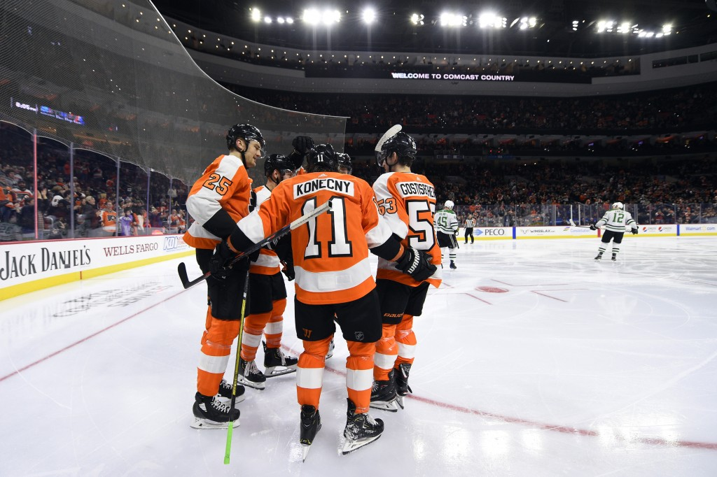 Philadelphia Flyers' Travis Konecny (11) celebrates with teammates after scoring a goal against the Dallas Stars during the second period of an NHL ho