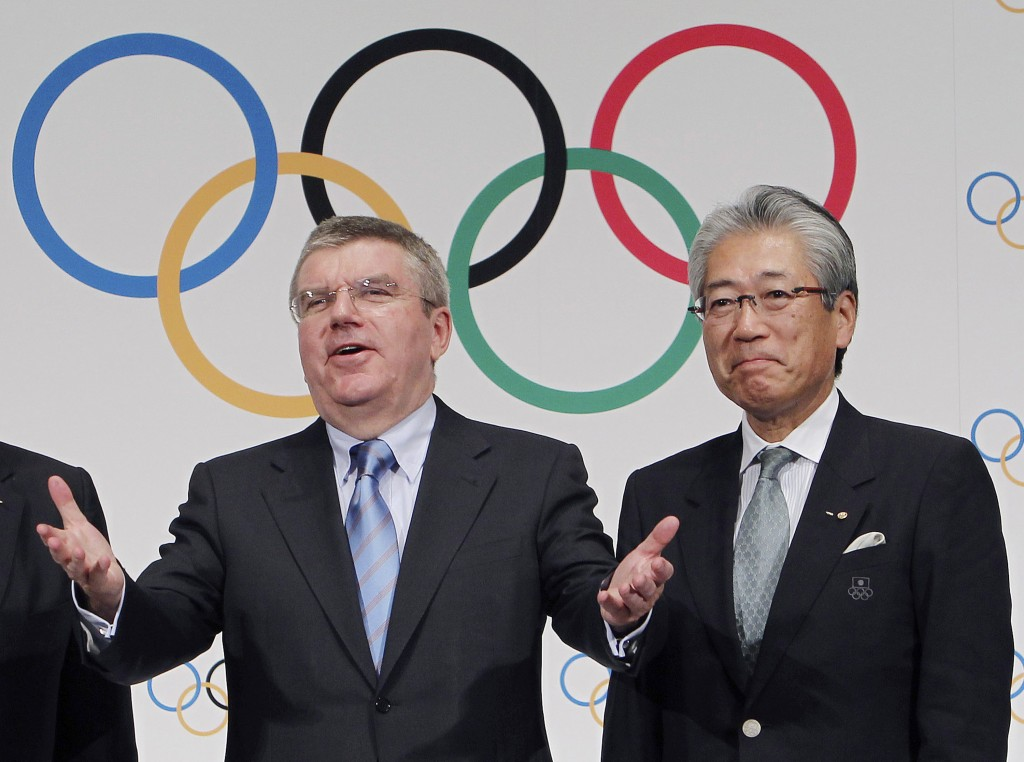 FILE - This Nov. 20, 2013, file photo shows Japan Olympic Committee President Tsunekazu Takeda, right, and  International Olympic Committee (IOC) Pres