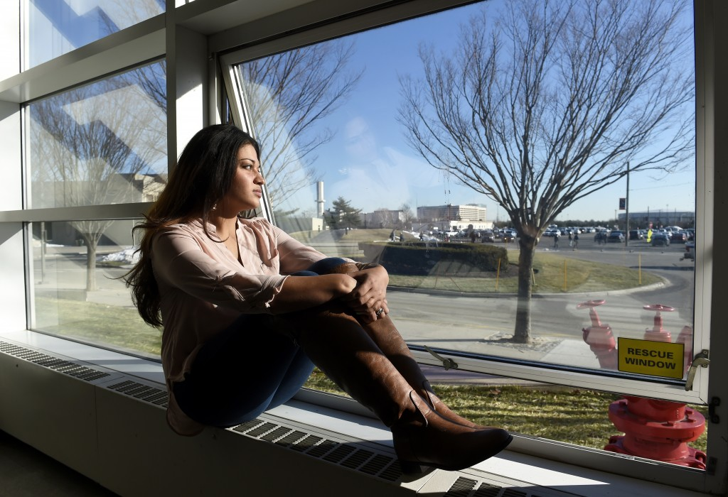 FILE - In this Feb. 2, 2016, file photo, Naila Amin, 26, looks out from a classroom window at Nassau Community College in Garden City, N.Y. According ...