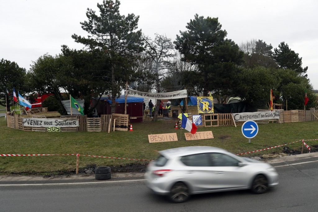 Protestors wearing yellow vests occupy a makeshift camp in a roundabout near Senlis, north of Paris, Thursday, Jan. 10, 2019. With its makeshift groce