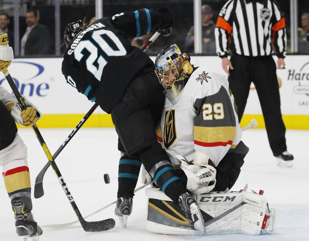 San Jose Sharks left wing Marcus Sorensen digs for the puck as Vegas Golden Knights goaltender Marc-Andre Fleury blocks a shot during the first period