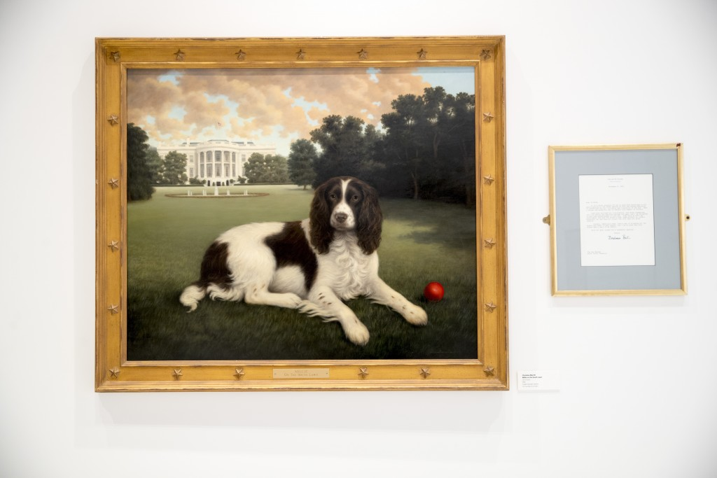 """This Wednesday, Jan. 9, 2019, photo shows """"Millie on the South Lawn"""" by Christine Merrill, alongside a letter from former first lady Barbara Bush on d..."""