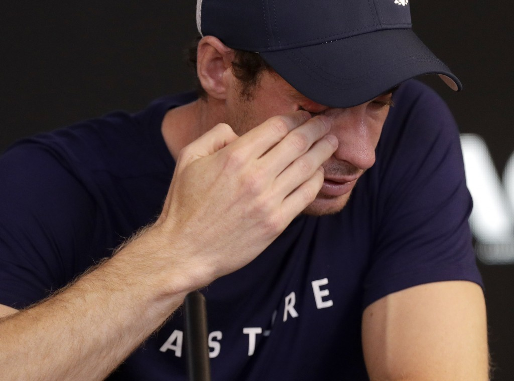 Britain's Andy Murray wipes tears from his face during a press conference at the Australian Open tennis championships in Melbourne, Australia, Friday,