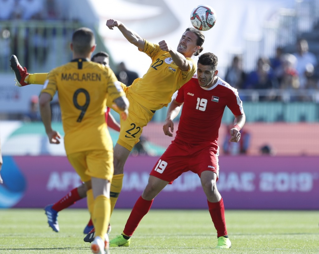 Australia's midfielder Jackson Irvine and Palestine's forward Mahmoud Wadi, right, vie for the ball during the AFC Asian Cup group B soccer match betw