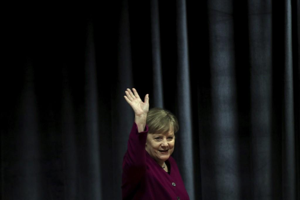 German Chancellor Angela Merkel waves the students during her visit in a German school in Athens, Friday, Jan. 11, 2019. Merkel is widely blamed in Gr