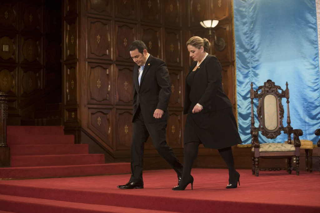 Guatemalan President Jimmy Morales, left, and Foreign Minister Sandra Jovel leave the National Palace after attending a welcoming ceremony for ambassa
