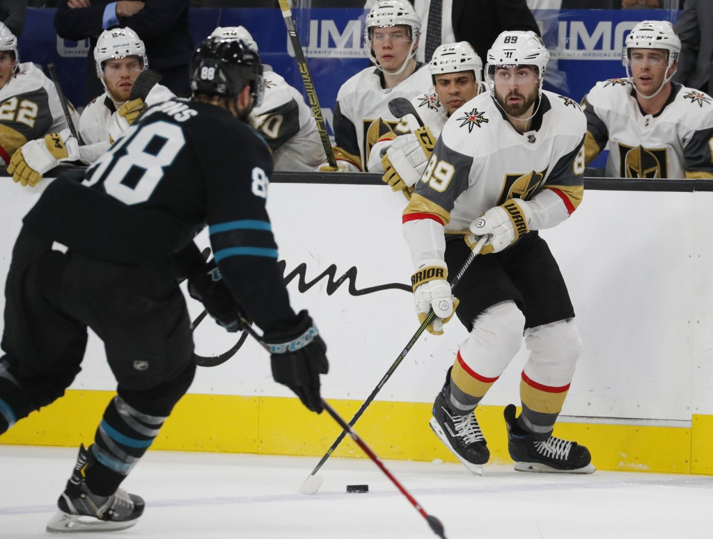 Vegas Golden Knights right wing Alex Tuch (89) passes the puck as San Jose Sharks defenseman Brent Burns defends during the second period of an NHL ho
