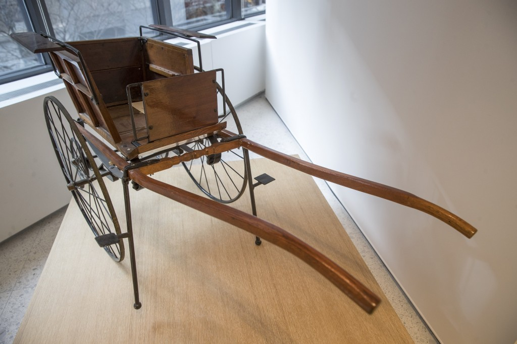 This Wednesday, Jan. 9, 2019, photo shows a Victorian Child's Dog Cart on display at the American Kennel Club Museum of the Dog in New York. The museu...