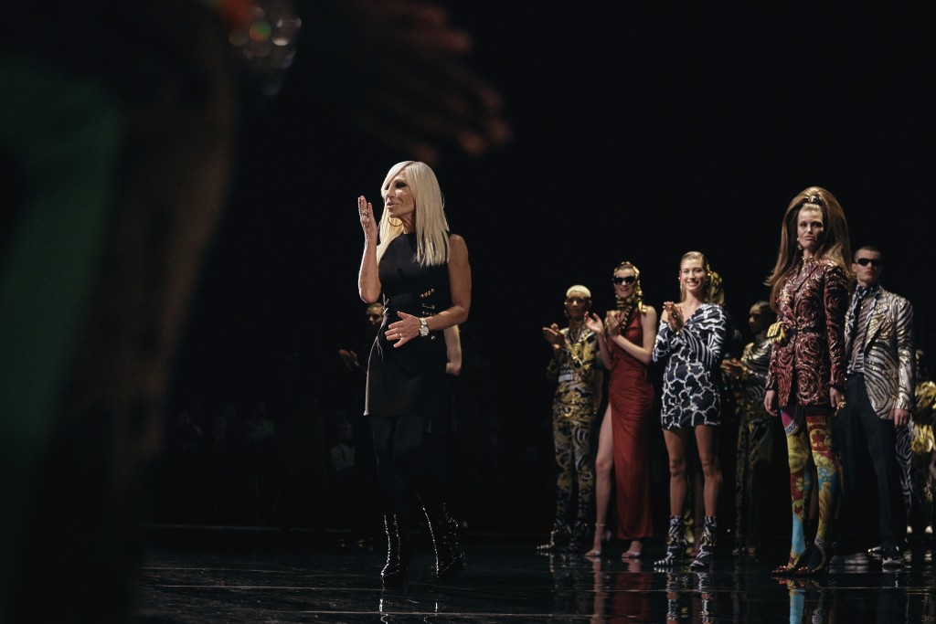 FILE - IN THIS  Dec. 2, 2018 file photo, Donatella Versace salutes during the Versace fashion show in New York. Gianni Versace's entrance into the fas