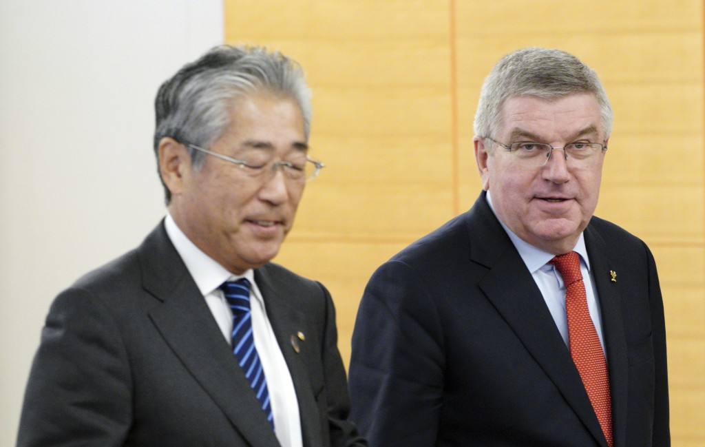 FILE - In this Nov. 30, 2018, file photo, International Olympic Committee (IOC) President Thomas Bach, right, escorts Japanese Olympic Committee (JOC)...