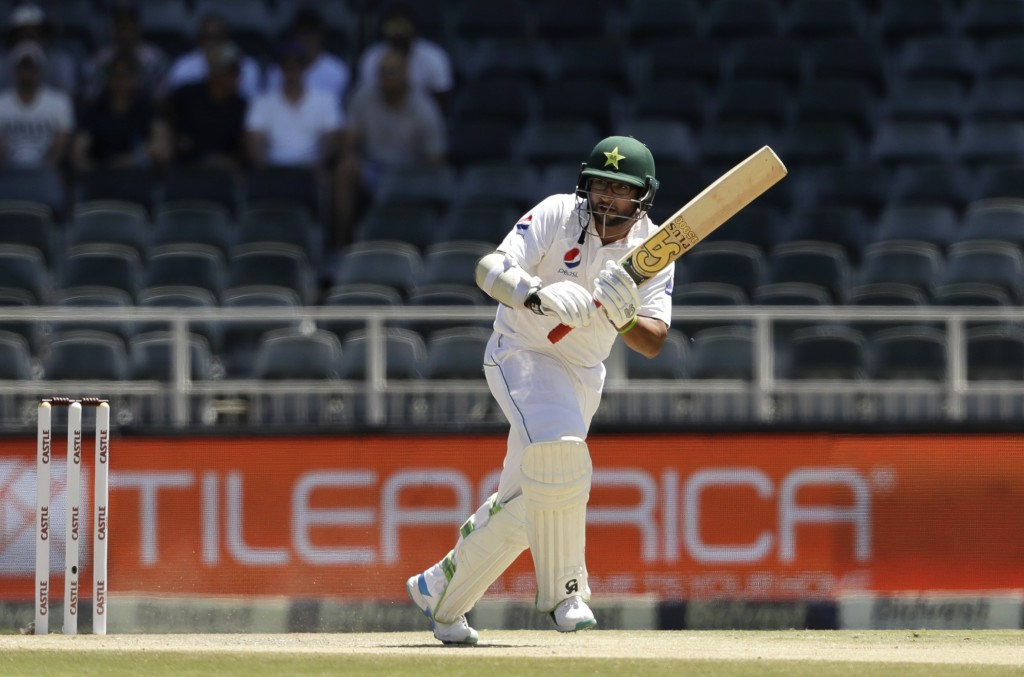Pakistan's batsman Imam-ul-Haq watches his shot on day two of the third cricket test match between South Africa and Pakistan at the Wanderers stadium
