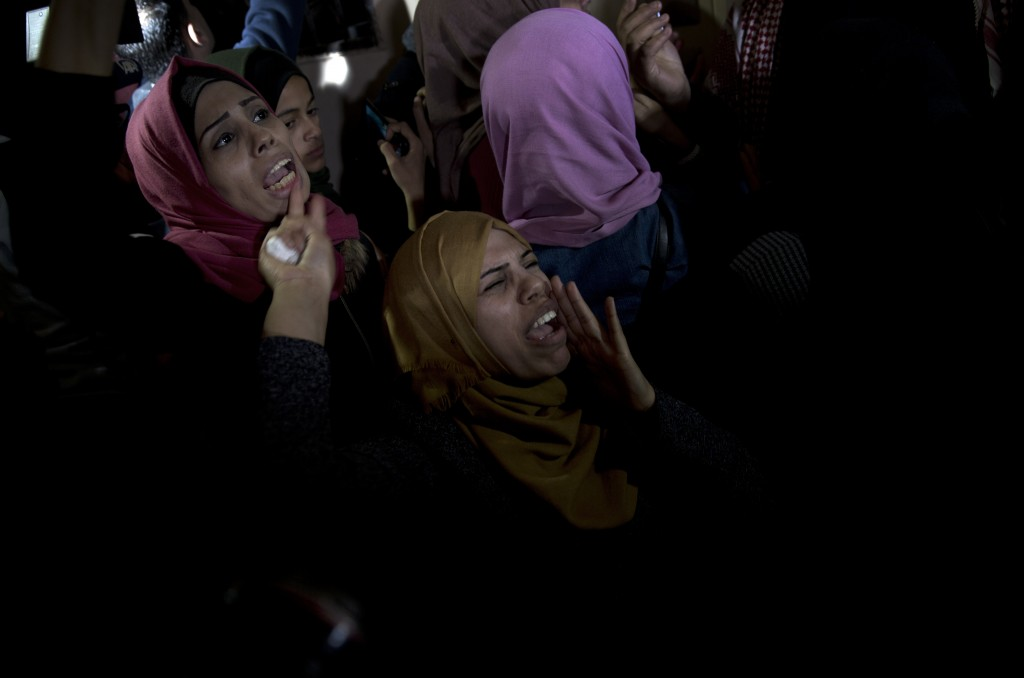 Relatives of Palestinian woman, Amal al-Taramsi, 43, who was killed by Israeli troops during Friday's protest at the Gaza Strip's border with Israel,