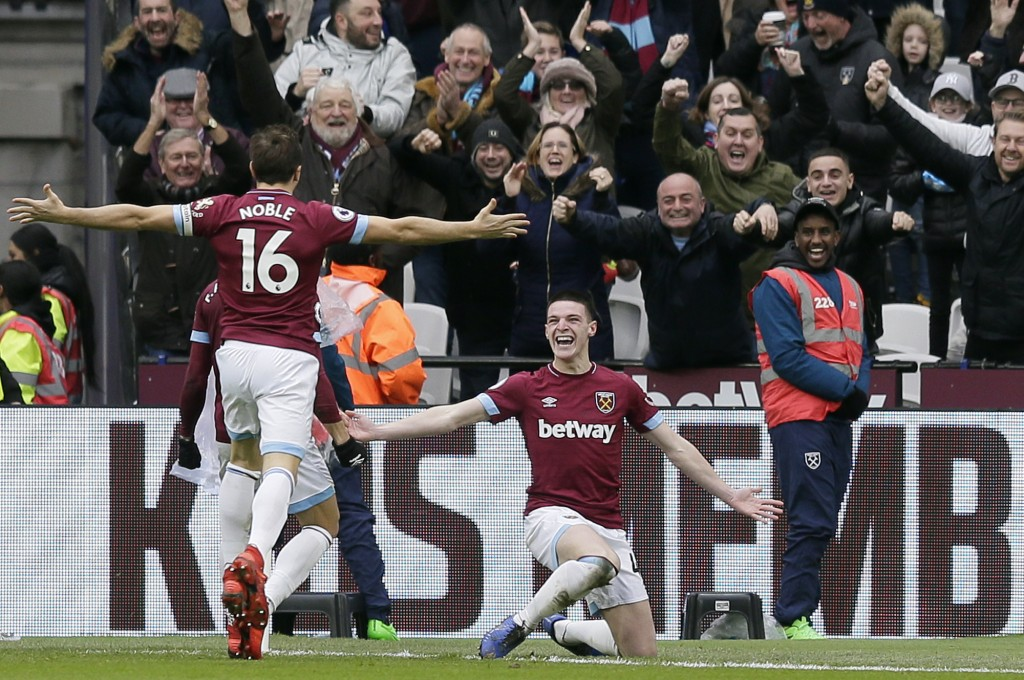 West Ham's Declan Rice, right, celebrates after scoring the opening goal during the English Premier League soccer match between West Ham United and Ar