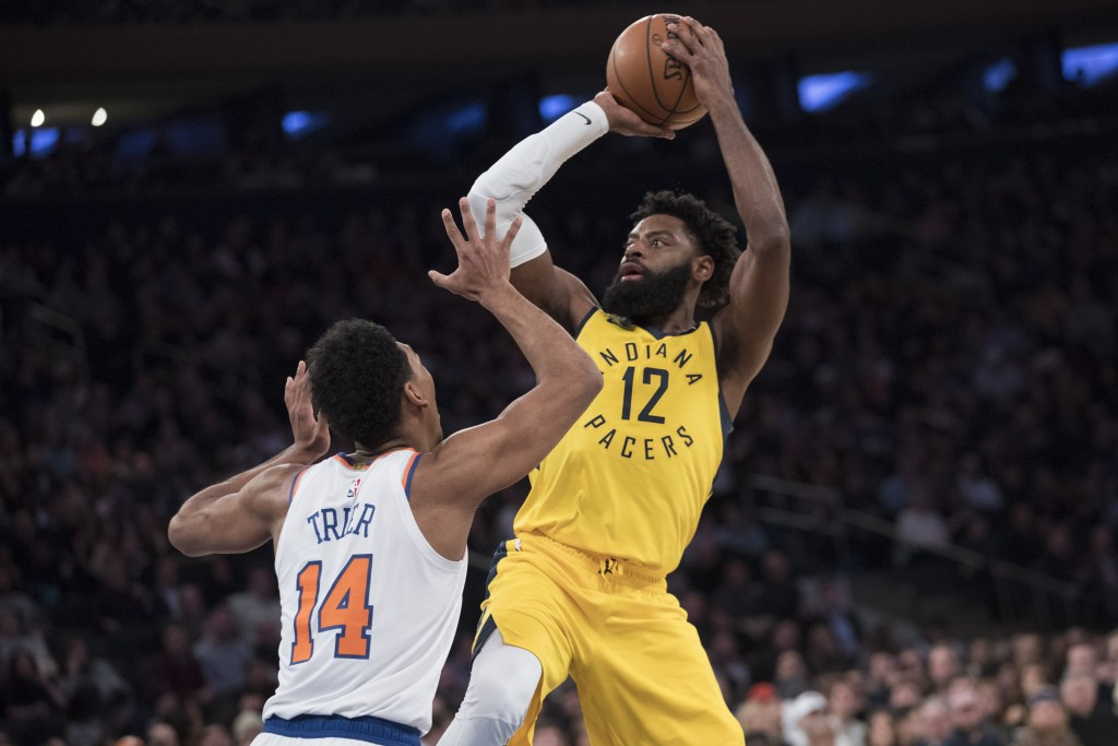 Indiana Pacers guard Tyreke Evans (12) shoots over New York Knicks guard Allonzo Trier (14) during the first half of an NBA basketball game Friday, Ja