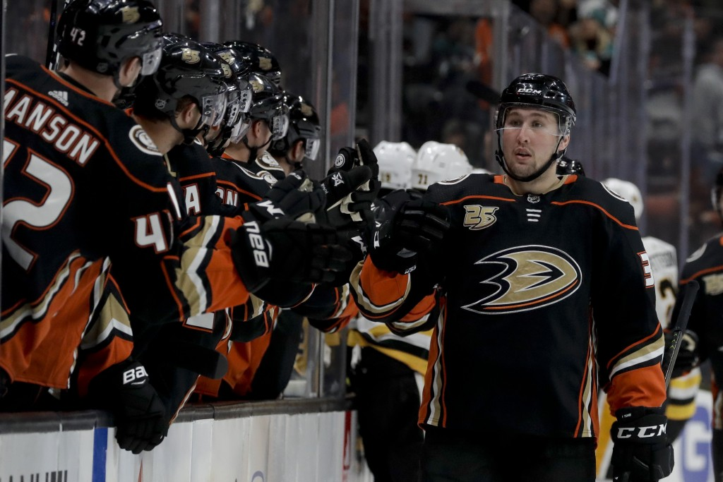 Anaheim Ducks left wing Nick Ritchie is congratulated after scoring against the Pittsburgh Penguins during the first period of an NHL hockey game in A