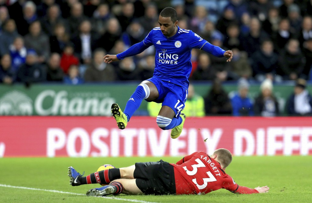 Leicester City's Ricardo Pereira, top, and Southampton's Matt Targett battle for the ball during the English Premier League soccer match at the King P...
