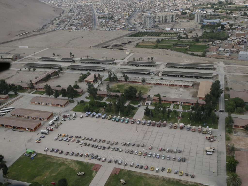 Cars and trucks are parked at a military base prior to the marathon stage five of the Dakar Rally between Tacna and Arequipa, Peru, Friday, Jan. 11, 2